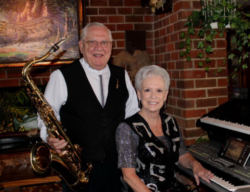 Photo of Denny with Sax and Dotty at Keyboard - DnD Music Co.